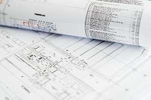 Une construction neuve commence par des plans de maçon